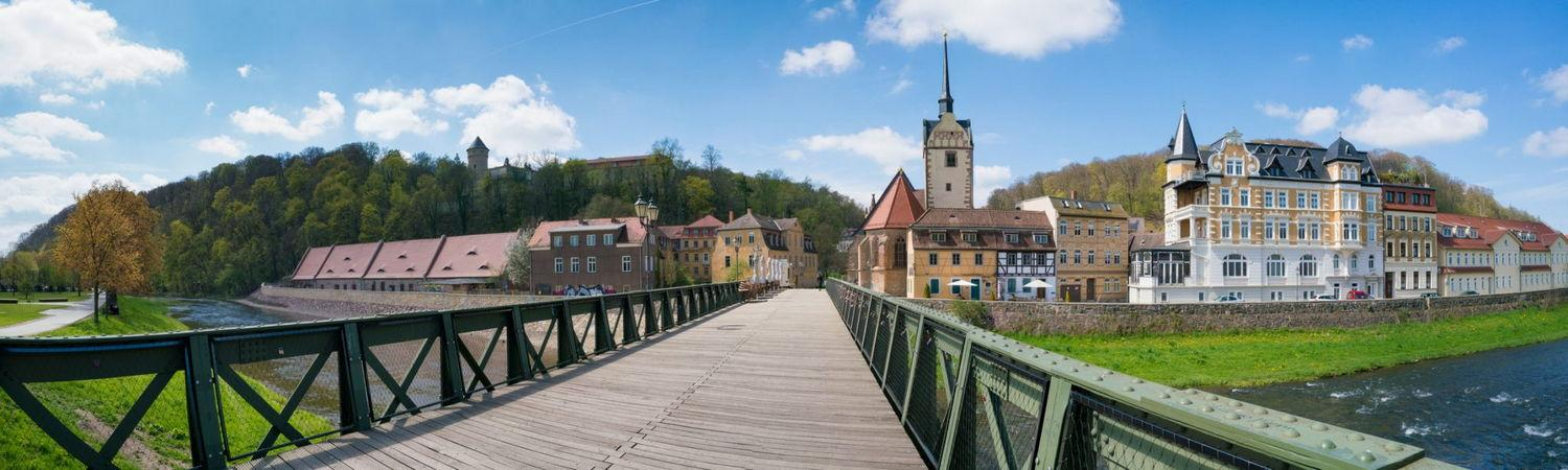 panorama of the bridge and the church in a small German town